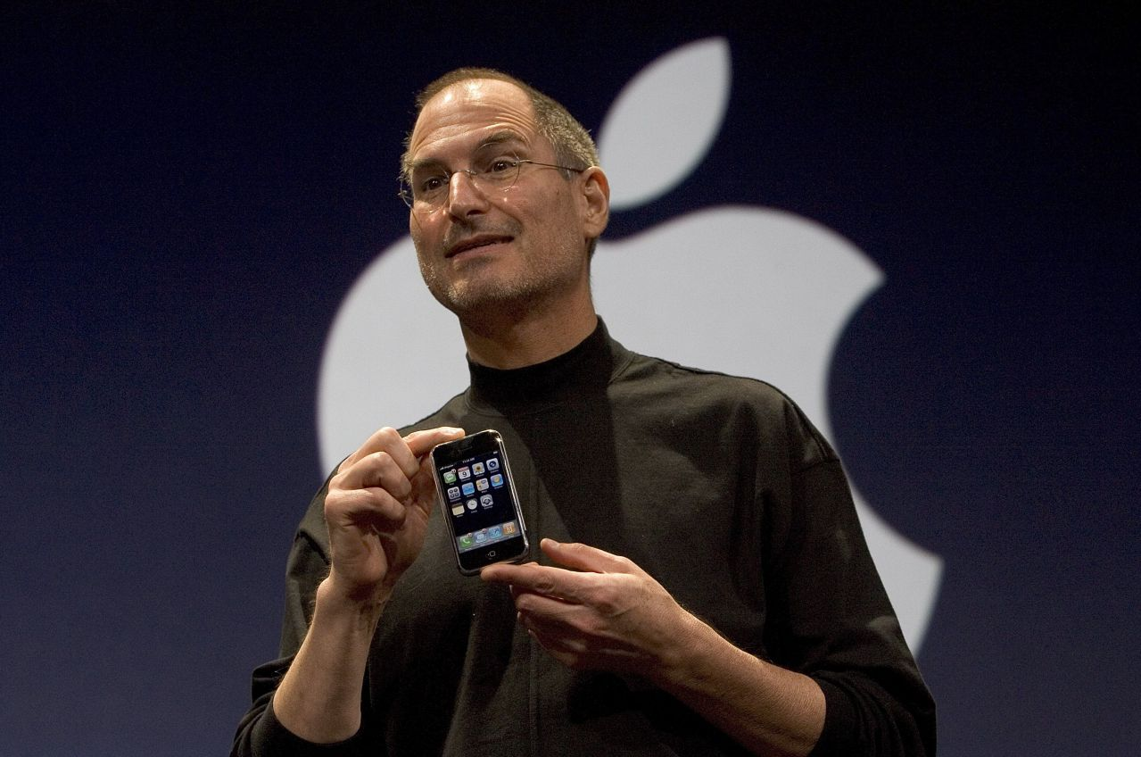 SAN FRANCISCO, CA - JANUARY 9: Apple CEO Steve Jobs holds up the new iPhone that was introduced at Macworld on January 9, 2007 in San Francisco, California. The new iPhone will combine a mobile phone, a widescreen iPod with touch controls and a internet communications device with the ability to use email, web browsing, maps and searching. The iPhone will start shipping in the US in June 2007. (Photo by David Paul Morris/Getty Images)